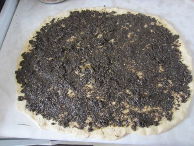 Spread paste of black olive and pickled jalapeno. Also sprinkle crush chilies and oregano